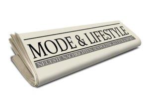 Zeitungsrolle mit Mode und Lifestyle