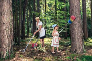symbolic picture with mother and daughter by cleaning of the forest