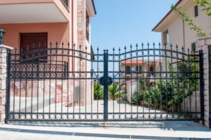 Steel security gates leading to a residential area