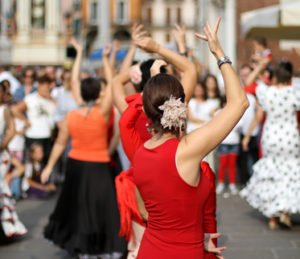 flamenco dancers expert and Spanish dance with elegant period costumes